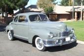 1947 Nash Ambassador Coupe med rak 6-cyl toppventilsmotor på 234,8 cu.in.